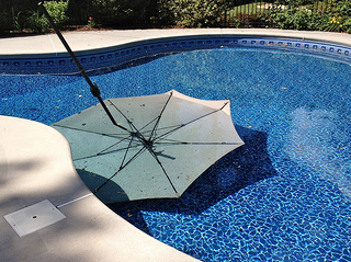 One Umbrella Flew Out Of The Patio Table Umbrella Hole Because We Hadnu0027t  Yet Purchased A Base For It. Another Free Standing One Wasnu0027t Screwed In  Tightly To ...
