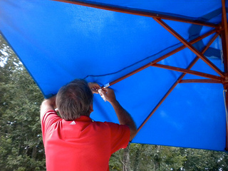 repairing a wood market umbrella
