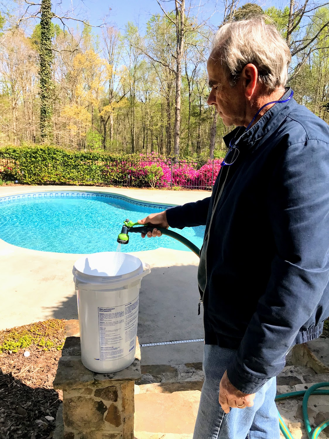 mixing chemicals for swimming pool